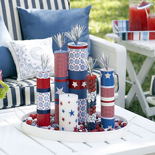 Adding stickers to candles and filling clear tubes with red white and